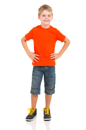 hands on hips: full length portrait of cute boy isolated on white background Stock Photo