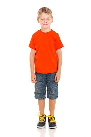 cute little boy standing on white background Stock Photo
