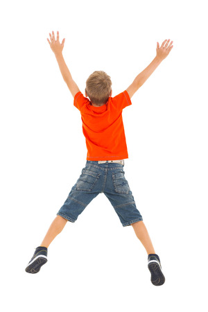 back view of little boy jumping on white background photo