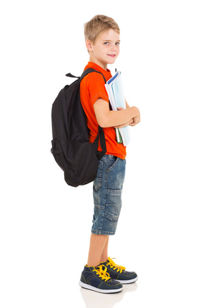 side view of male elementary school student with backpack photo