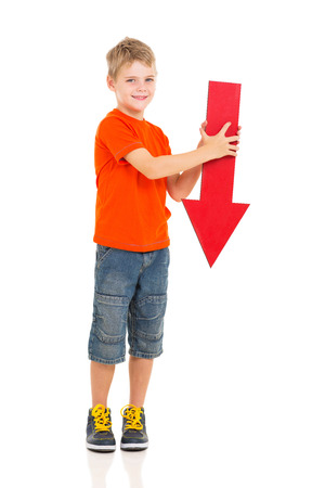 portrait of cute boy holding red arrow pointing down photo
