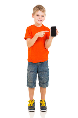 cute boy pointing at smart phone on white background Stock Photo