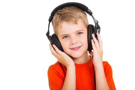 cute little boy with headphones isolated on white photo
