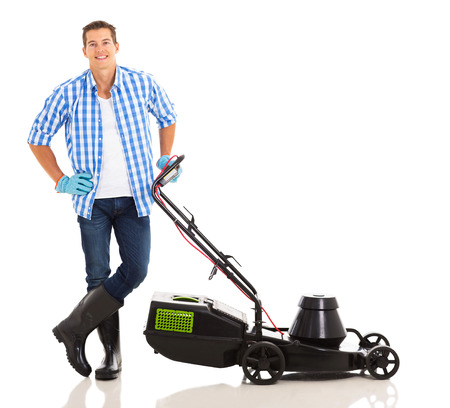 young man standing next to lawnmower on white background