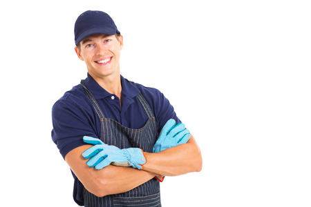 handsome young farmer wearing garden gloves isolated on white background photo