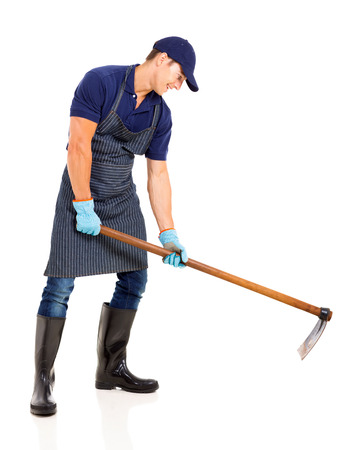 hoe: gardener working with a hoe isolated on white background Stock Photo