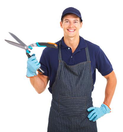 garden shears: Jardinero joven sosteniendo tijeras de jard�n aislado en blanco