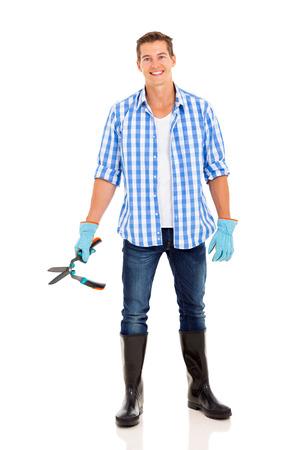 garden shears: Retrato de cuerpo completo del hombre joven con tijeras de jard�n