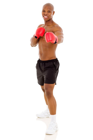 young african boxer doing exercise on white background photo