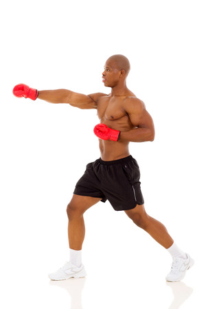side view of african american man boxing photo