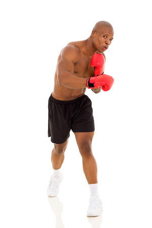strong african man boxer with red gloves photo