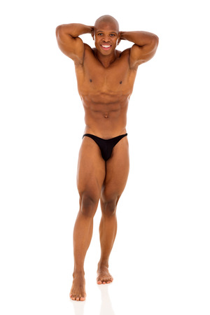 young african bodybuilder posing on white background photo