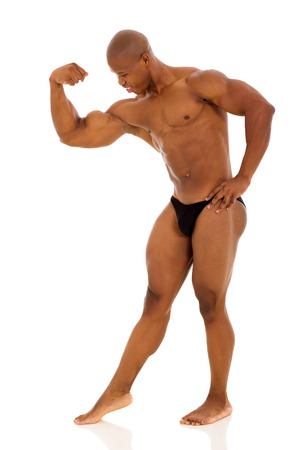 handsome afro american bodybuilder flexing muscles photo