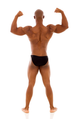 rear view of male african bodybuilder standing on white background photo