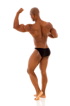 back view of black bodybuilder flexing muscle isolated on white background photo