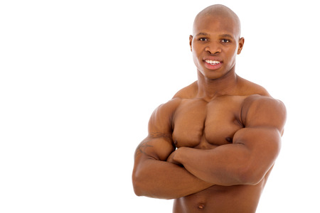 close up portrait of african bodybuilder with arms crossed photo