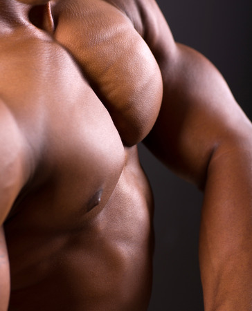 african muscular man body closeup shot photo