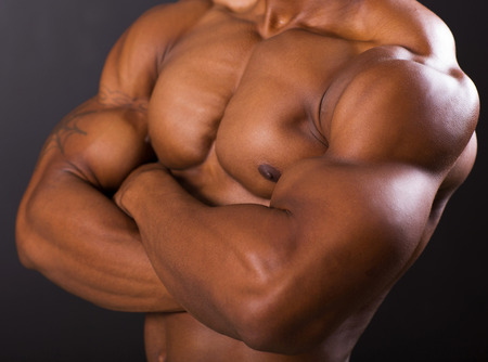 muscular african man body closeup