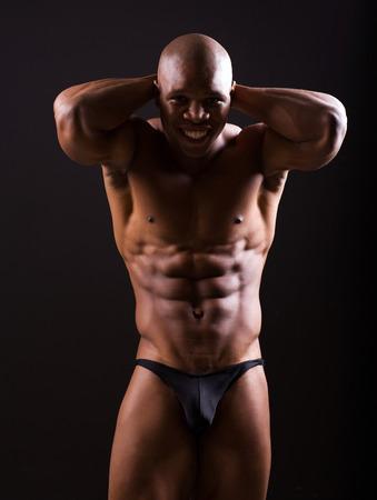 cheerful young bodybuilder posing in studio photo
