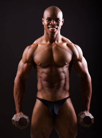 male male torso: good looking muscular black man holding two dumbbells