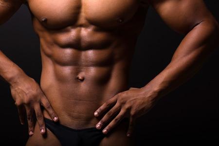 muscle building: closeup of muscular african man 6 packs