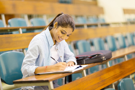 class room: happy university student studying in lecture room