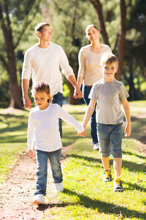 walk in: happy family walking together outdoors