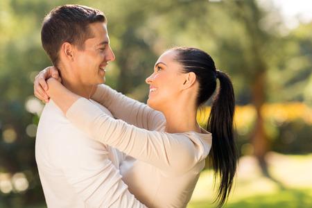 happy loving romantic couple embracing outdoors photo