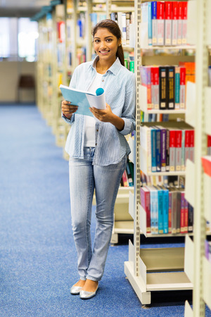 jeans woman: portrait of female university student in library