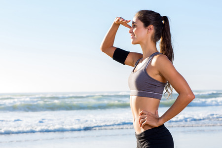 side view of healthy woman looking into distance  photo