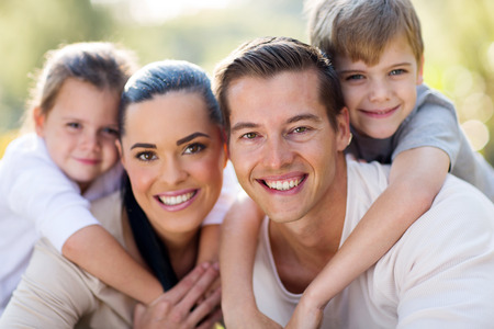 piggy back: loving young family having fun together outdoors Stock Photo