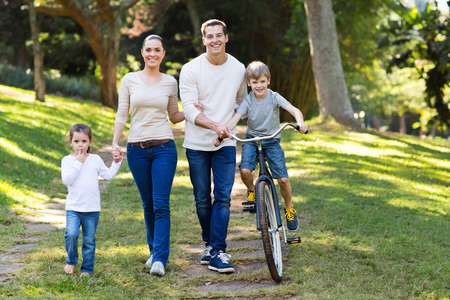 happy young family spend quality time together in the park photo