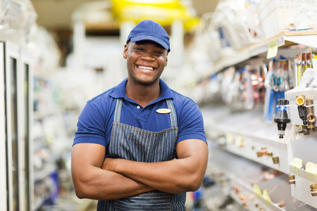 fittings: cheerful afro american hardware worker with arms crossed