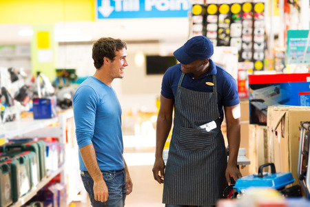 african hardware store salesman assisting customer shopping photo