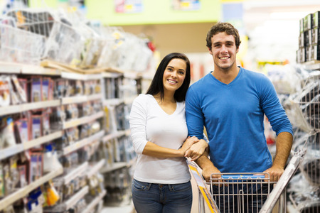 young couple shopping at hardware store photo