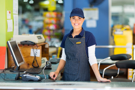 beautiful woman working as a cashier at the supermarket Stock Photo