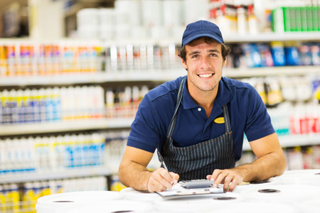 home improvement store: handsome young male hardware store worker