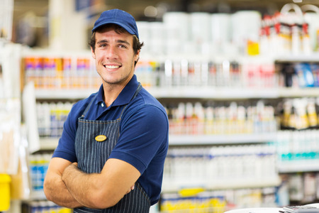 portrait of male supermarket worker with arms crossed photo