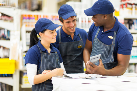 group of hardware store workers discussing work Stock Photo