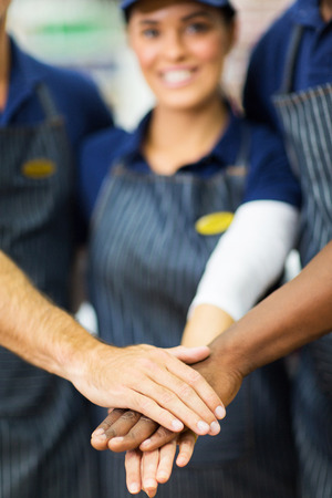 close up portrait of supermarket workers hands together photo