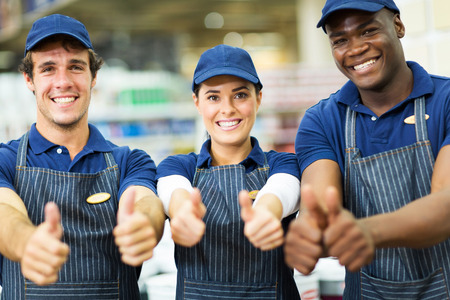 group of happy supermarket workers thumbs up photo