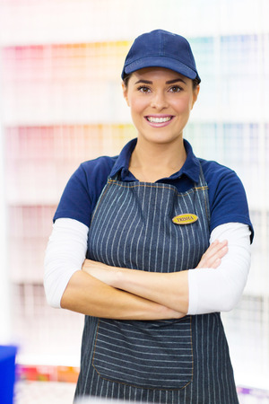 portrait of cute female paint store worker photo