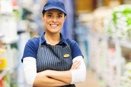 portrait of pretty female supermarket worker  photo