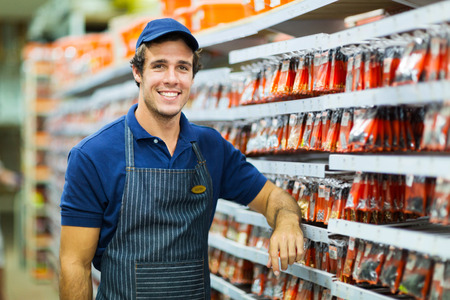 sales clerk: happy hardware store worker looking at the camera Stock Photo