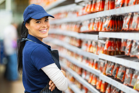 smiling hardware store worker looking at the camera