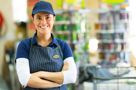 home improvement store: pretty hardware store employee looking at the camera Stock Photo