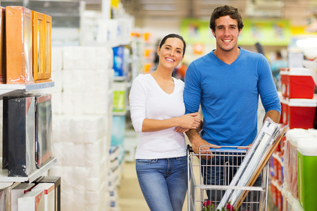 portrait of couple shopping together at supermarket photo