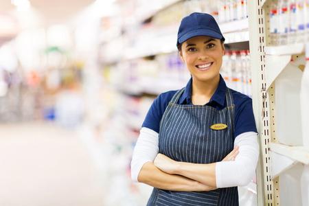 shop assistant: portrait of pretty supermarket shop assistant