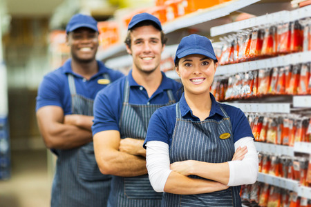 group of smiling hardware store co-workers photo