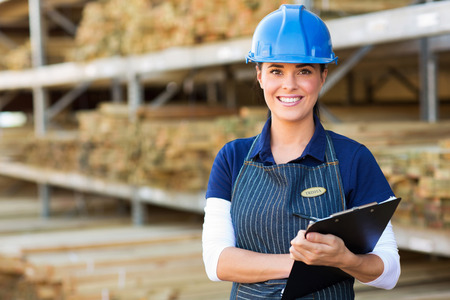 beautiful female industrial worker holding clipboard photo